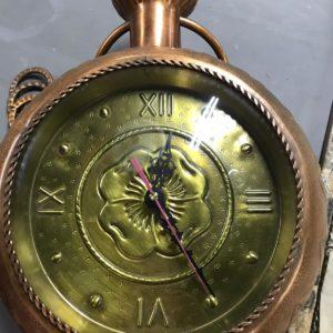 Orologio antico in rame